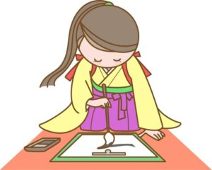 書き初めをする和服の女性